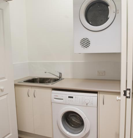 Laundry for Small bathroom designs with washing machine